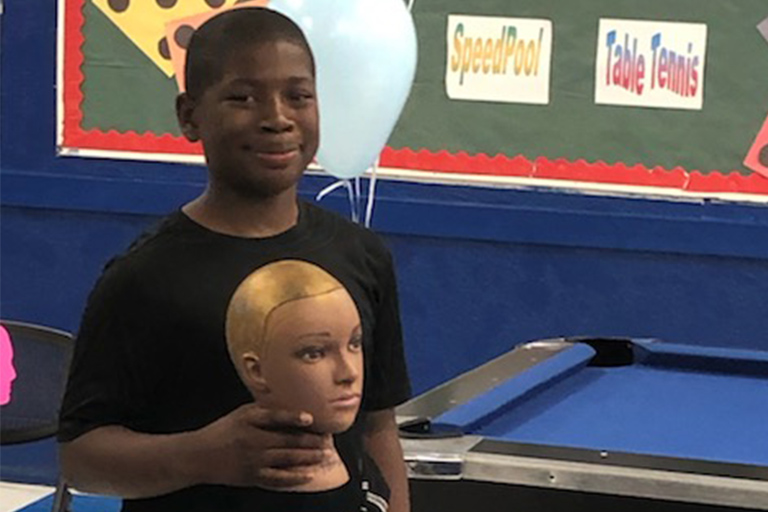 Boys holding his hair head