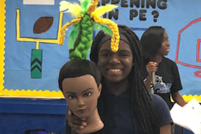 Girl holding her hair head