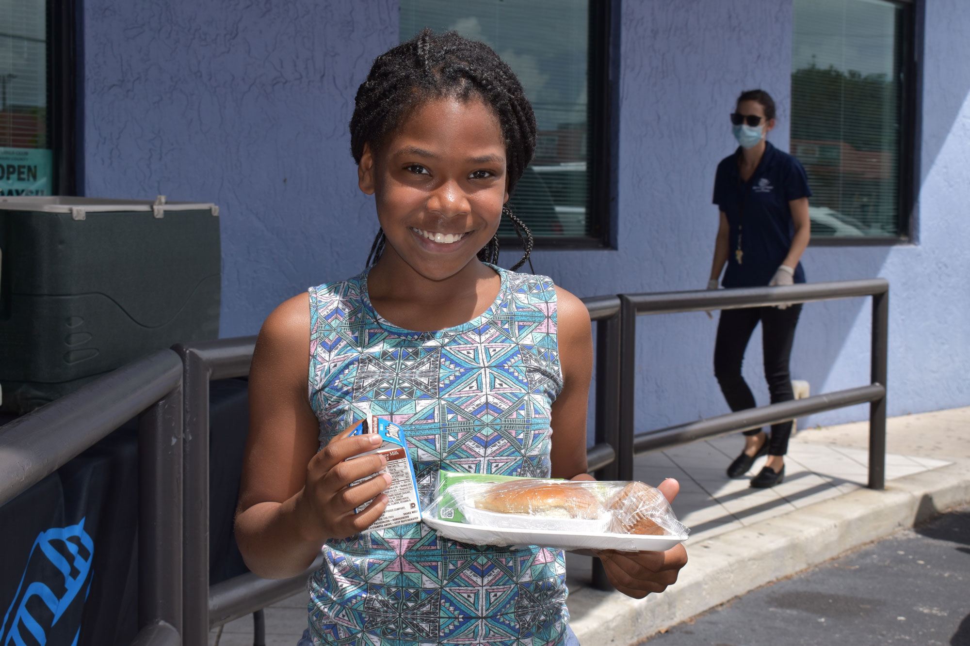 Young girl receiving lunch.