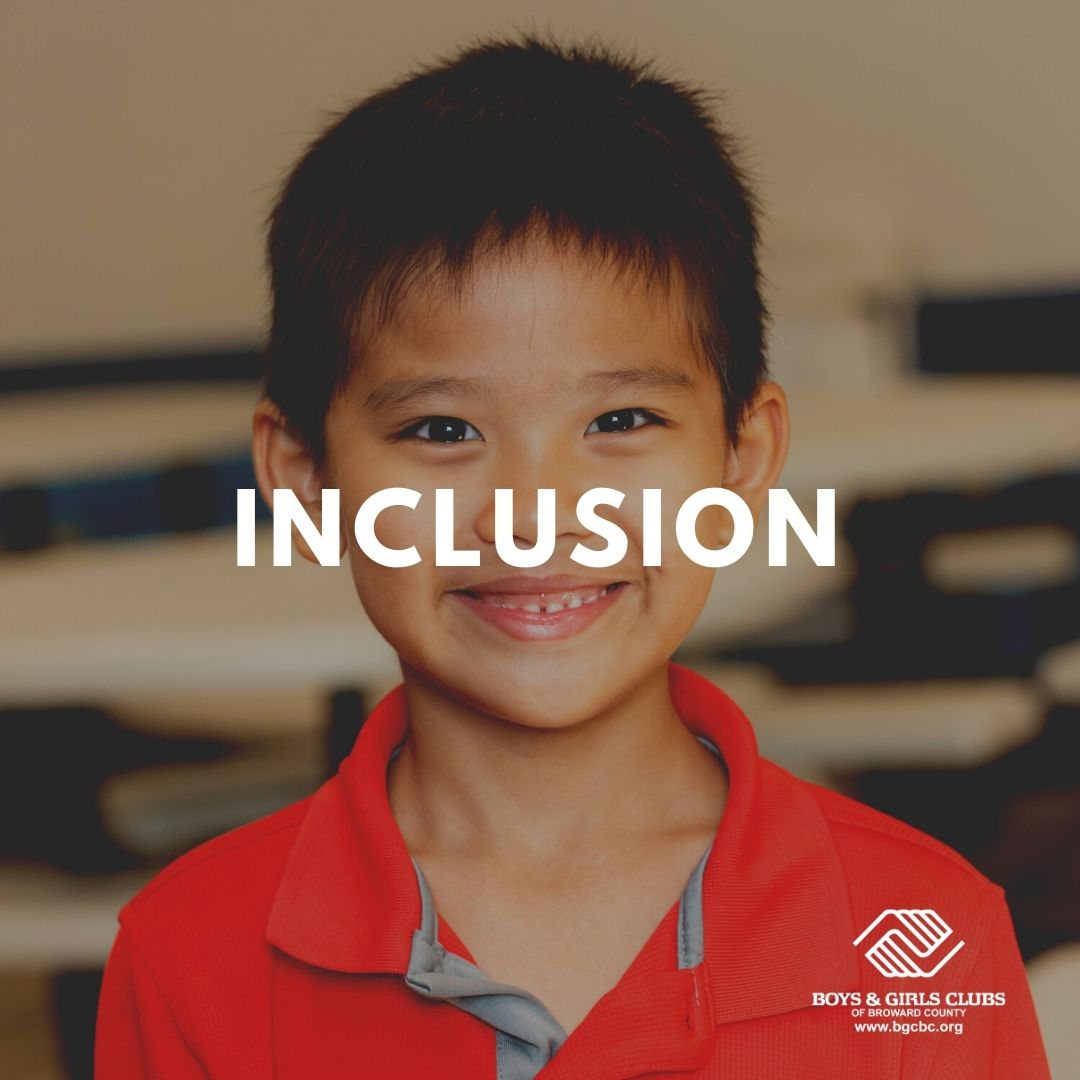 A young smiling boy with the word Inclusion