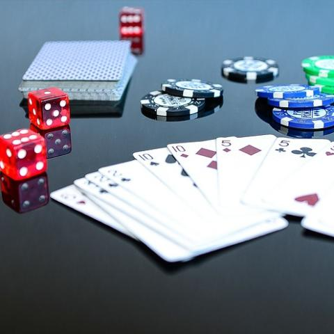 Poker cards, chips and dice